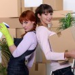 Young women cleaning out their apartment on moving day — Stock Photo #8421214