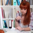 Stressed student in library — Stock Photo