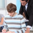 Stock Photo: Teacher checking pupils work