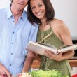 Portrait of a couple cooking — Stock Photo #8422536