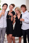 Two young couples drinking champagne — Stock Photo