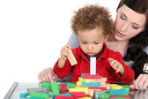 Woman and child playing with wooden blocks — Stock Photo