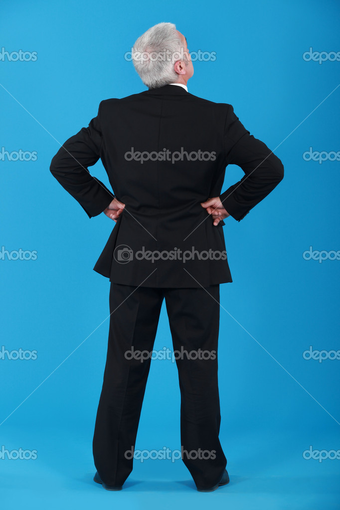 A mature businessman turning his back at the camera. — Stock Photo #8421504