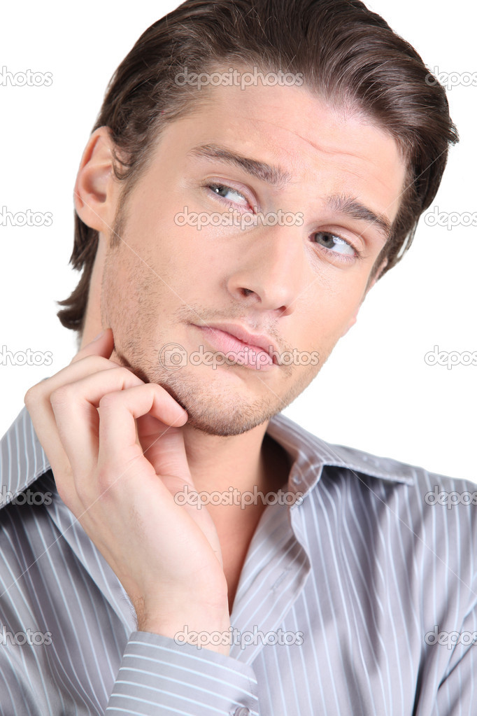 Handsome guy puzzled — Stock Photo #8422055