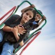 Children with a dog on a slide — Stock Photo #8453873