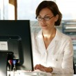Busy female office worker — Stock Photo #8455061