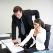Business couple working on project — Stock Photo
