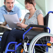 Disabled female office worked with colleague — Stock Photo #8455601
