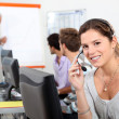 Young woman taking a business call on a headset — Stock Photo