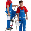 Two decorators stood by ladder - Foto Stock