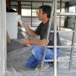 Decorator painting a room - Stockfoto