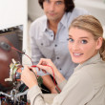 Female technician repairing television — Stock Photo #8457142