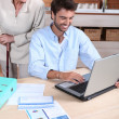 Happy doing accounting at home — Stock Photo