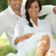 Portrait of beautiful couple dressed in white — Stock Photo