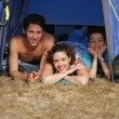 Family on a camping trip - Stock Photo
