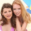 Two female friends by the pool. — Stock Photo