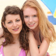 Two female friends by the pool. - Foto Stock