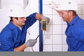 Couple of electricians working — Stock Photo