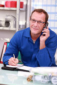Craftsman on the phone — Stock Photo