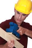 Craftsman sanding wood lath — Stock Photo
