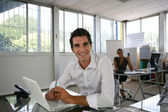 Businessman working at his desk — Stock Photo