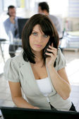 Receptionist taking a call — Stock Photo