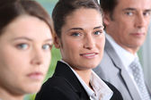 Head shot of three dynamic businesspeople — Stock Photo