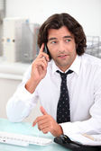 Male office worker sat at desk — Stock Photo