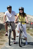 Young couple on bike ride — Stock Photo