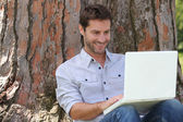 Portrait of a man with laptop — Stock Photo