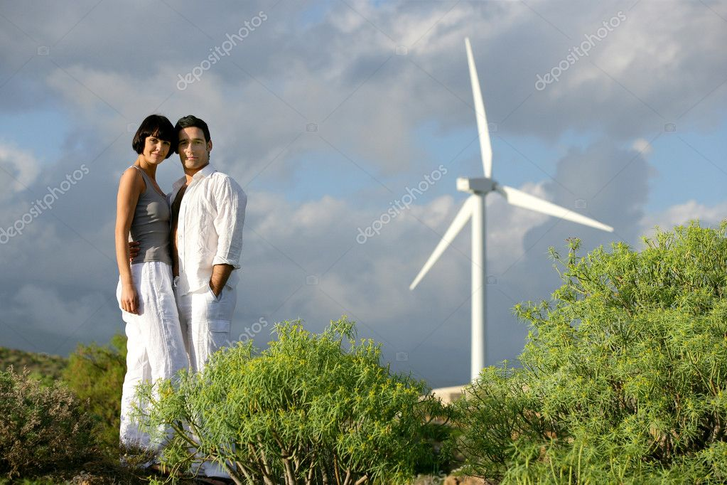 Couple stood on wind farm — Stock Photo #8457347
