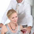 A man serving wine to a woman at the start of a posh dinner. — Stock Photo #8460777