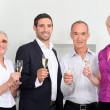 A family toasting with sparkling wine - Stock Photo