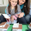 Female architect at home with young daughter — Stock Photo