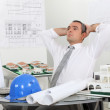 Architect relaxing in his office — Stock Photo
