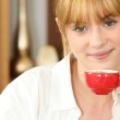 Young woman drinking a cup of expresso coffee — Stock Photo