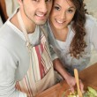 Royalty-Free Stock Photo: Couple cooking in the kitchen