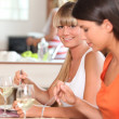 Stock Photo: Women eating dinner together