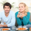 Young couple having meal at home — Stock Photo #8465243