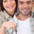 Mid life couple with the keys to their new home — Stock Photo
