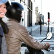 Foto Stock: Trendy couple on moped
