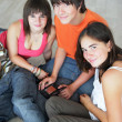 Stock Photo: Teens with console
