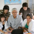 Pupils with their teacher and a laptop — Stock Photo