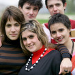 Group of teenagers gathered in local park — Stock Photo