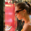 Attractive woman window shopping — Stock Photo