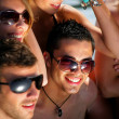 Group of young on a beach holiday — Stock Photo