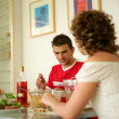 Couple eating a meal together at home - Foto Stock