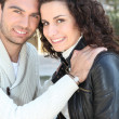 Young couple smiling outdoors - Foto Stock