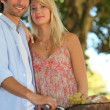 Stock Photo: Summery couple with basket of fruit