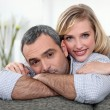 A nice couple cuddling on a couch. — Stock Photo #8469651
